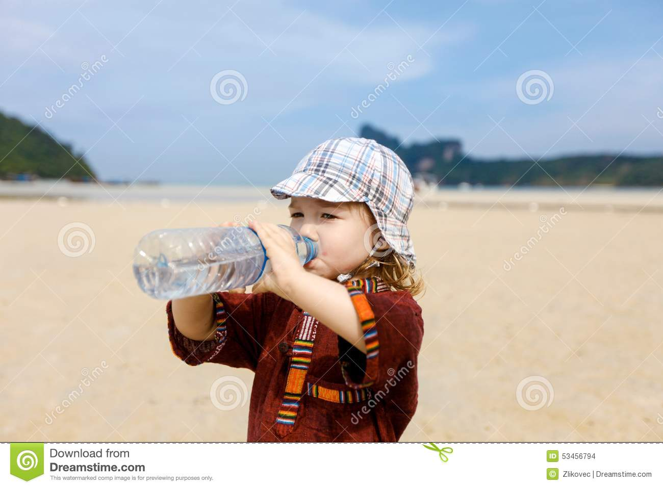 Child On Tropical Beach, Drinking Bottled Water Stock ...