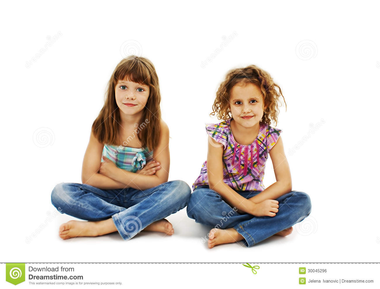 A child two girls sitting on the floor stock photo for On the floor