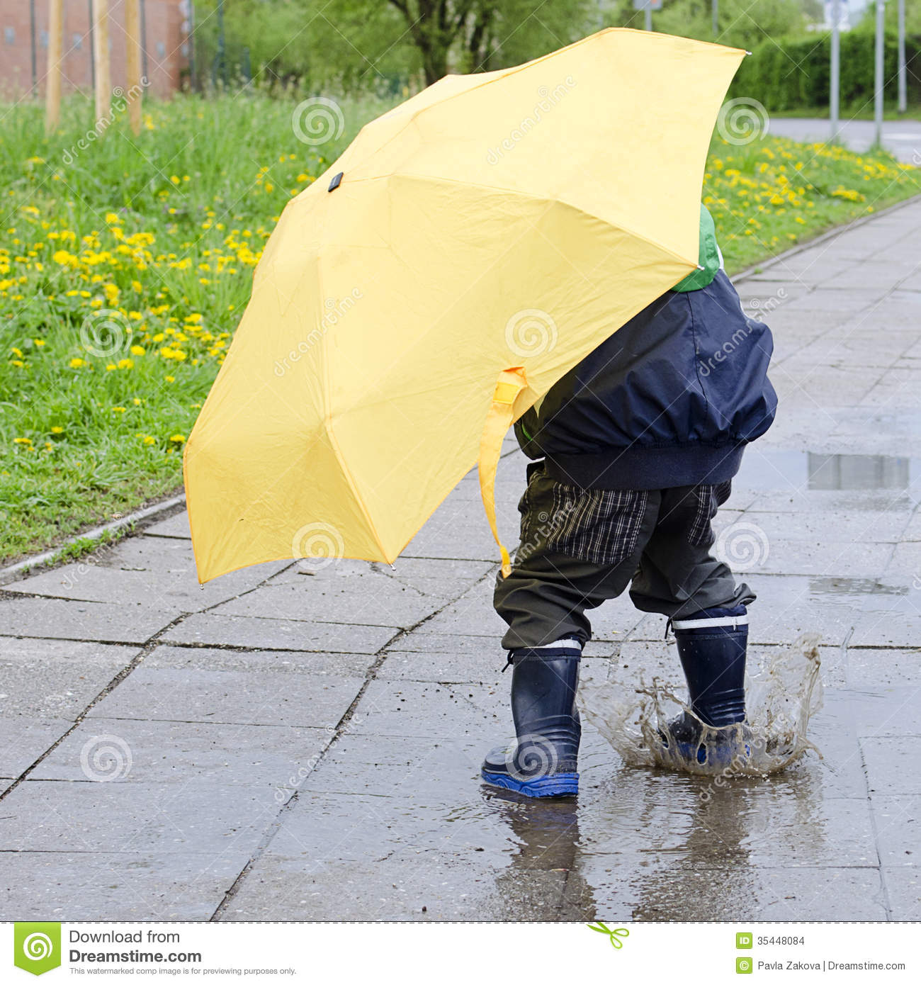 Child With Umbrella In Puddle Stock Photo Image 35448084