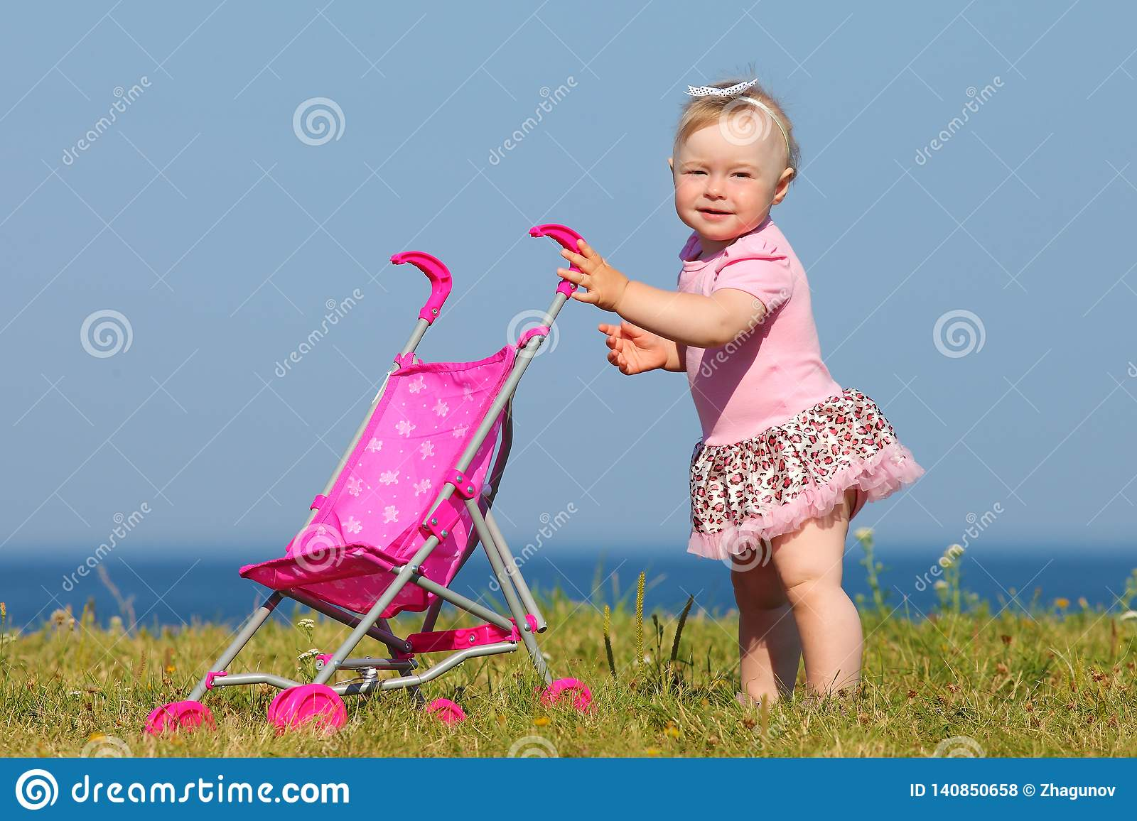 Child walks by the sea
