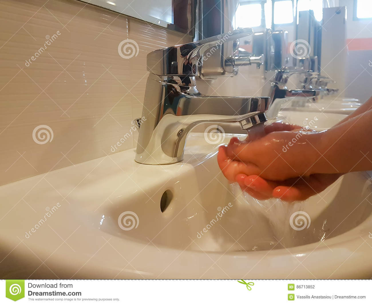 Child Washing His Hands Inside A School Kids Mini Toilet. Stock ...