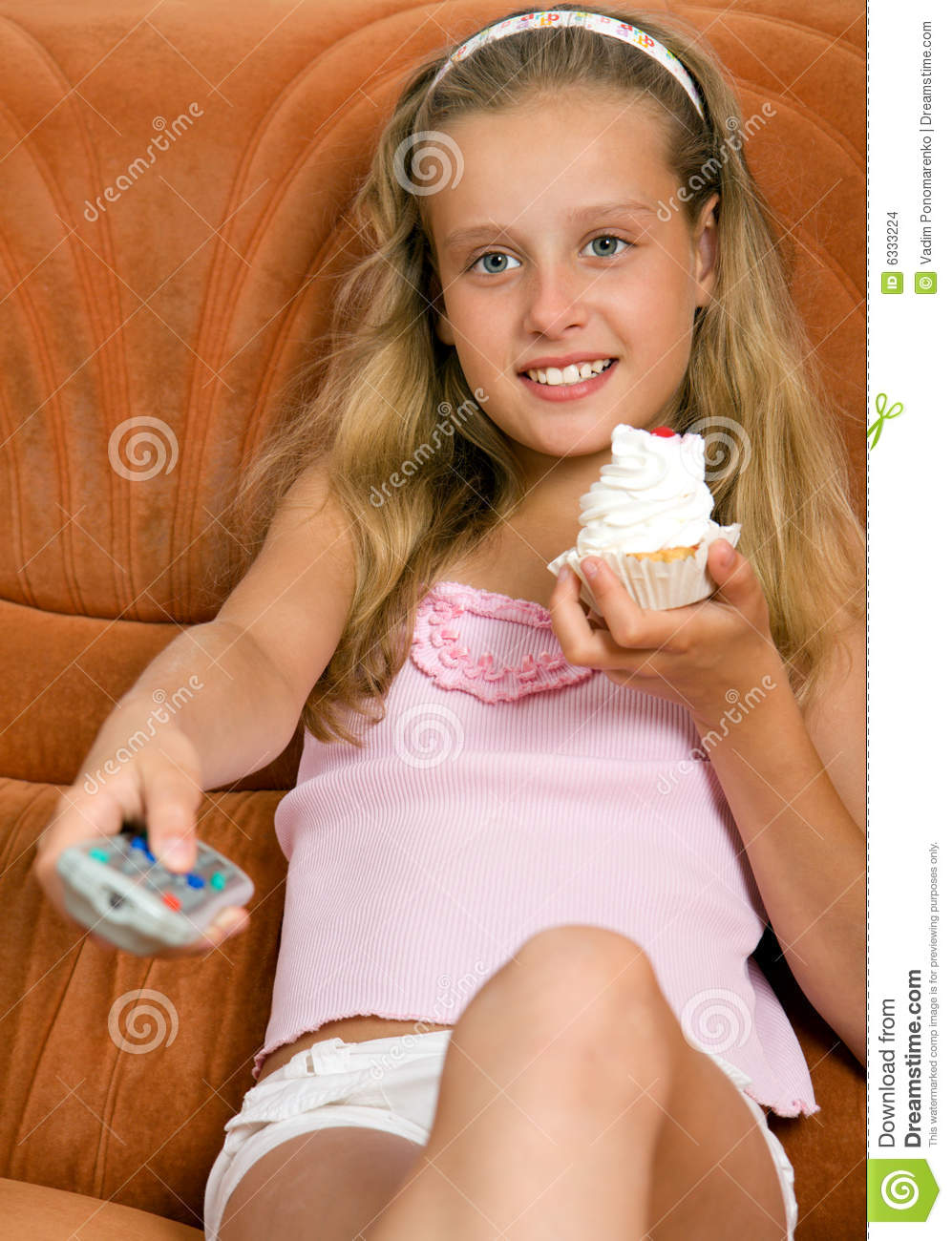 Child watching tv and eating cake