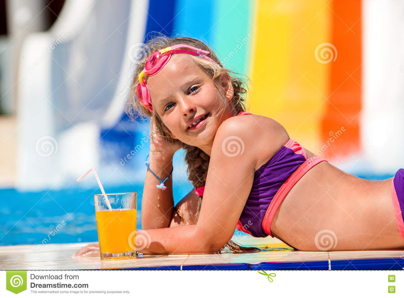 Child On Water Slide At Aquapark Drinking Cold Squeezed Orange Juice Stock Photo Image 72616018