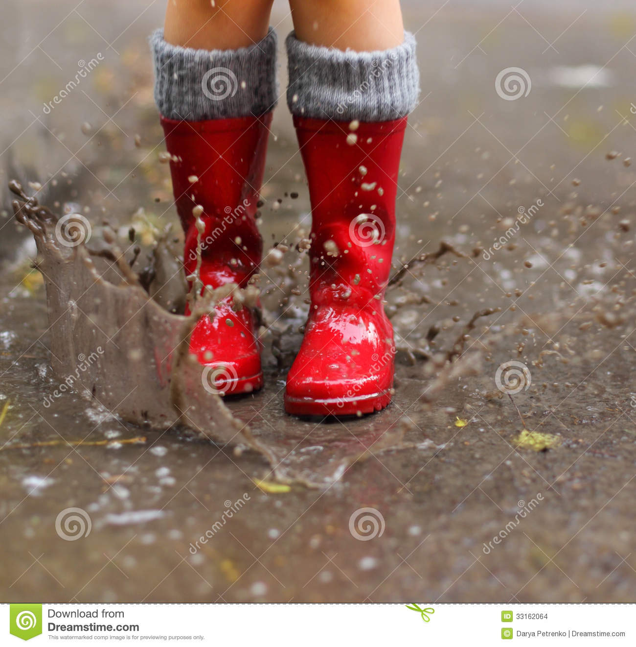 8634d03ec77 Child Wearing Red Rain Boots Jumping Into A Puddle Stock Photo ...