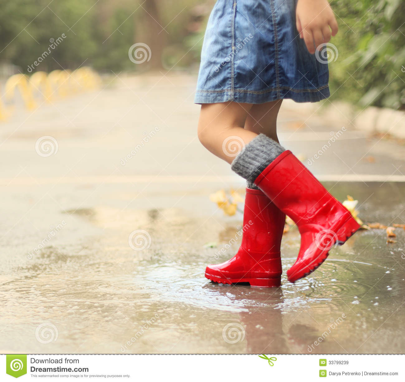 Child Wearing Red Rain Boots Jumping Into A Puddle Stock Photo ...