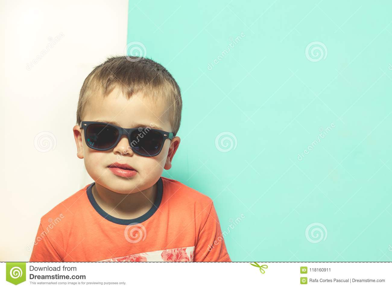 c50bc5274f3a Child wearing sunglasses with a serious attitude. Blond Kid with sunglasses.  More similar stock images