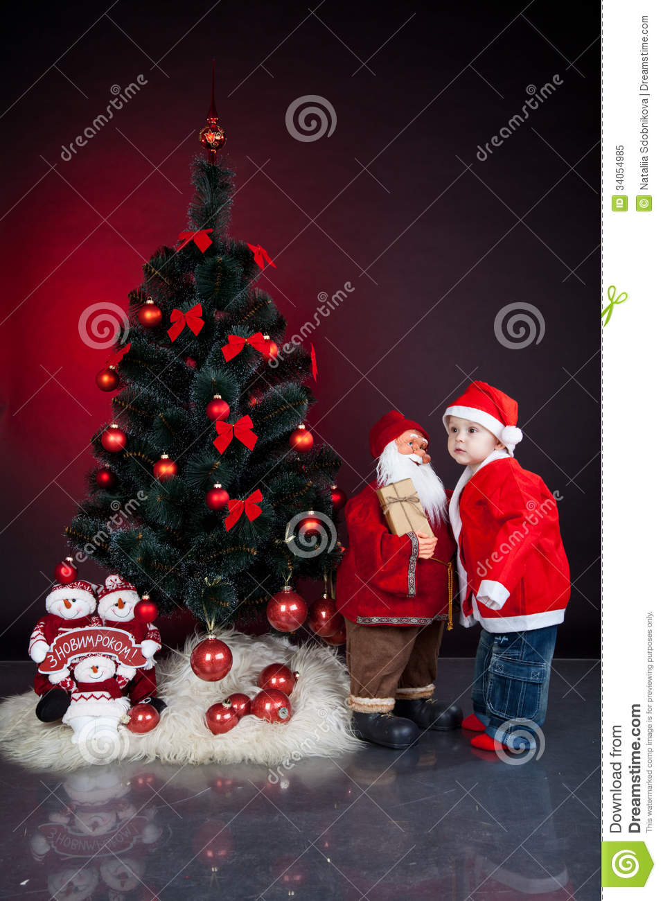 Child with xmas decoration royalty free stock photo for Baby christmas tree decoration