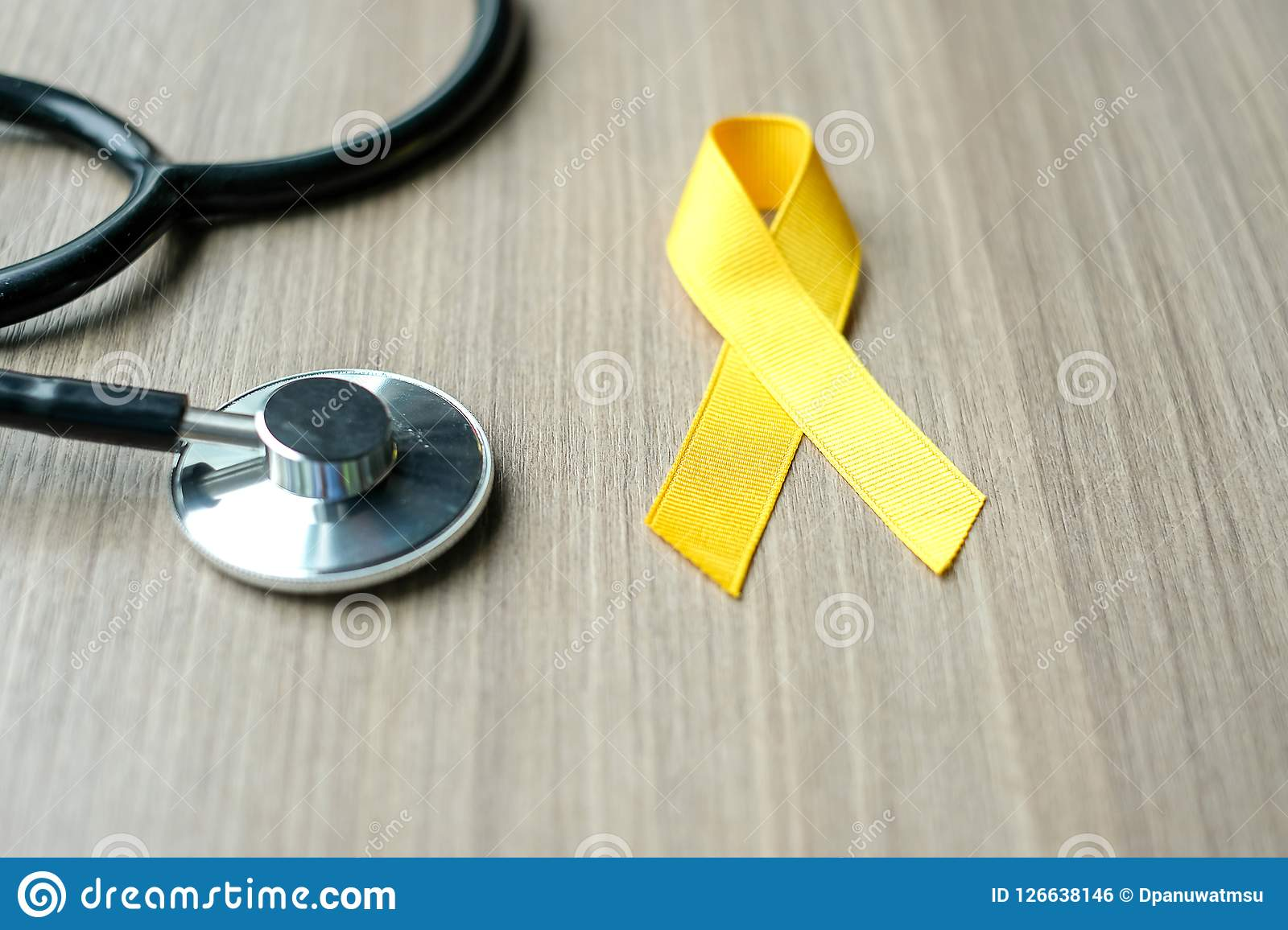Childhood Cancer Awareness, Yellow Ribbon with stethoscope for supporting people living