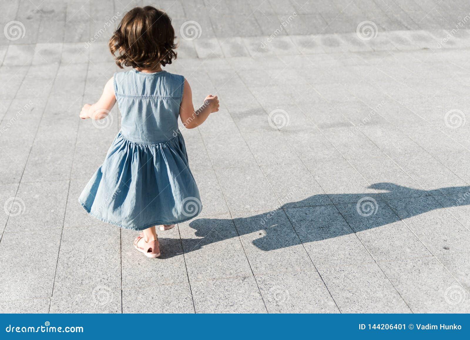 Childhood concept. Cute preschool girl is running