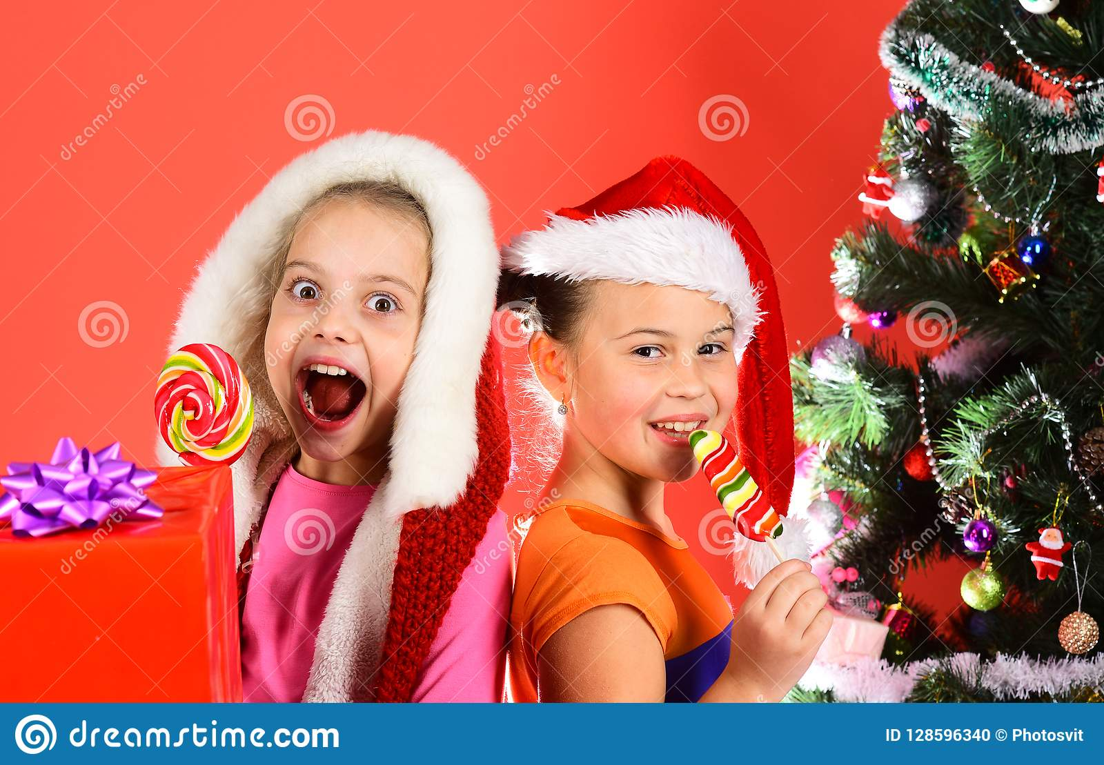 819e0b050 Childhood And Happiness Concept. Kids In Santa Hats Stock Photo ...