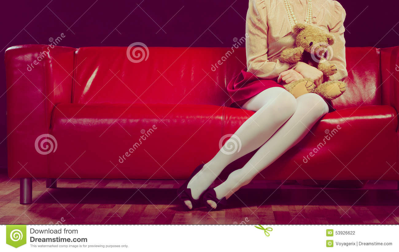 Fantastic Childlike Woman And Teddy Bear Sitting On Couch Stock Photo Machost Co Dining Chair Design Ideas Machostcouk
