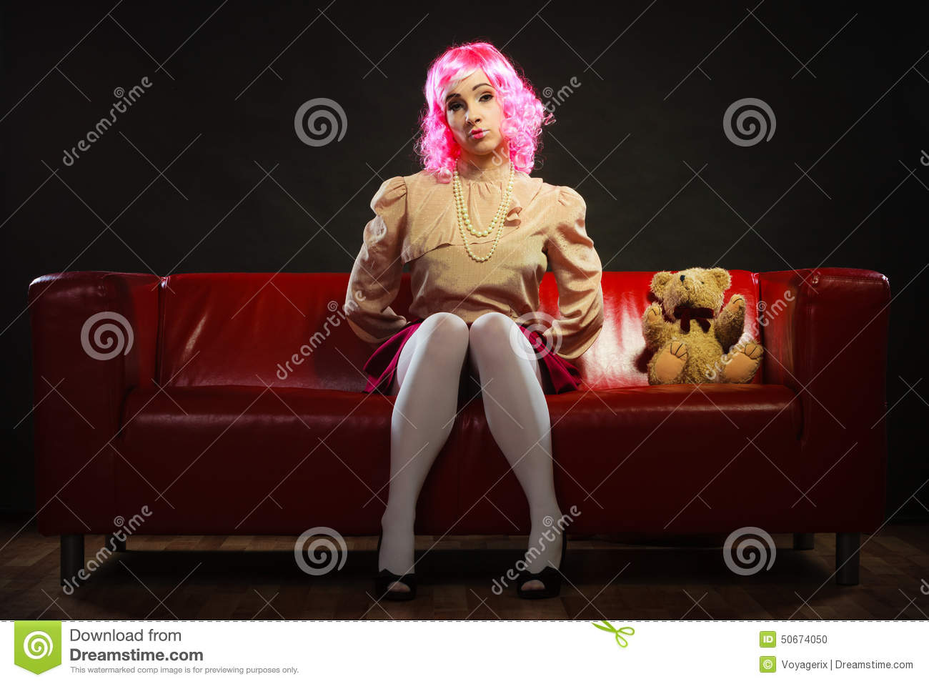 Peachy Childlike Woman And Teddy Bear Sitting On Couch Stock Photo Machost Co Dining Chair Design Ideas Machostcouk