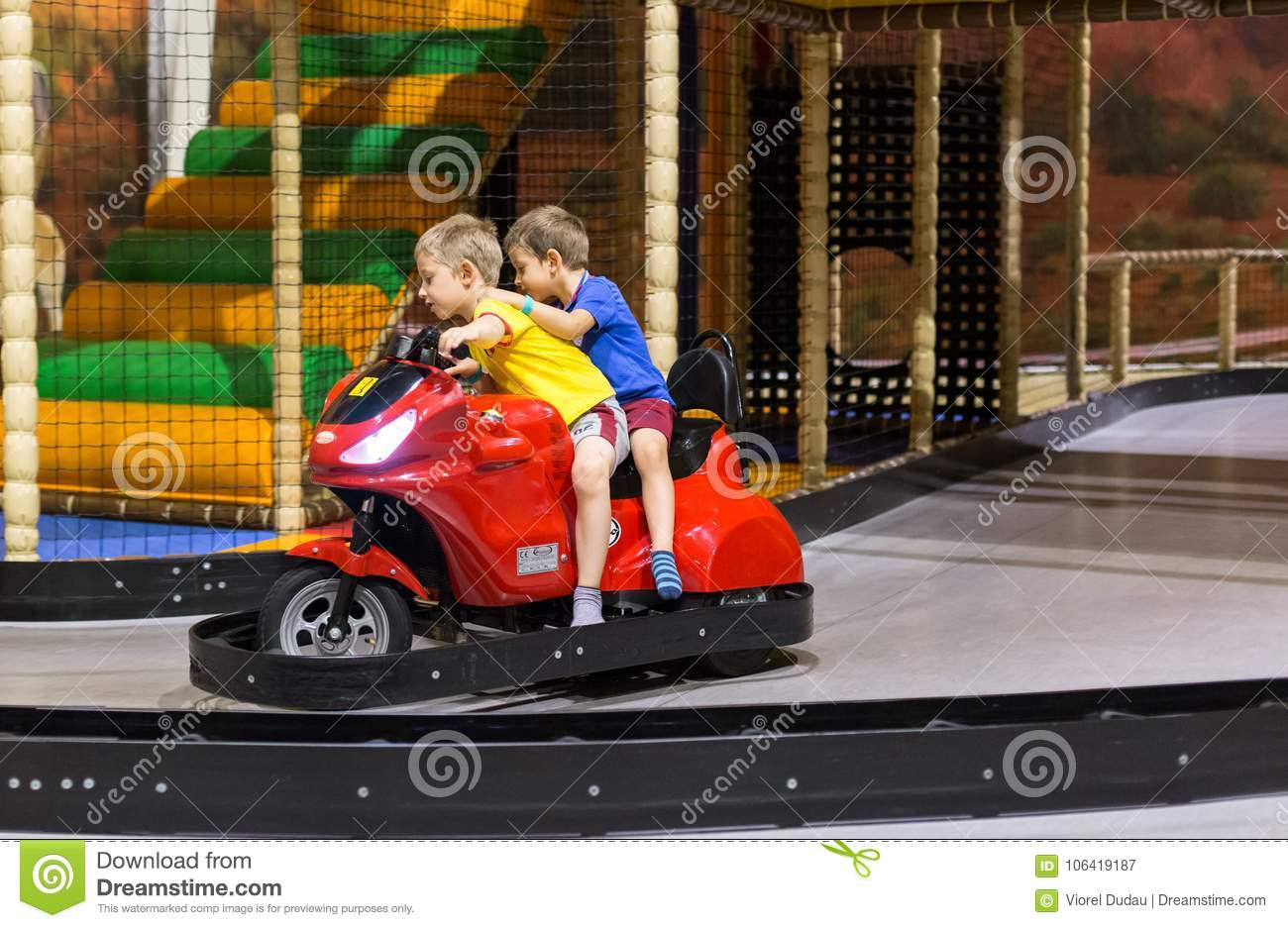 Children on amusement park ride