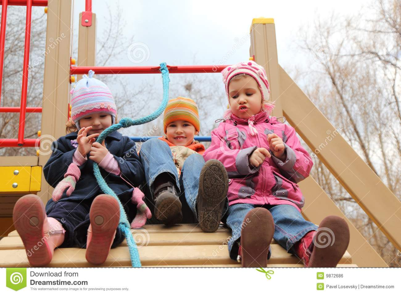 Children On Artificial Hill On Playground Royalty Free