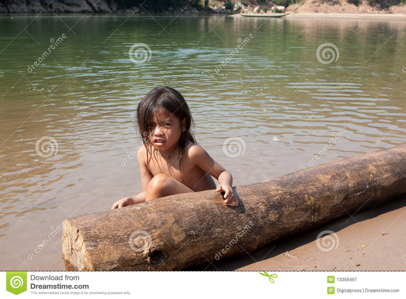 laos child girl bath Ban Na, Laos - April 10, 2018: Mother and child having a community bath  together in a river in the deep counstryside of Laos 211975666