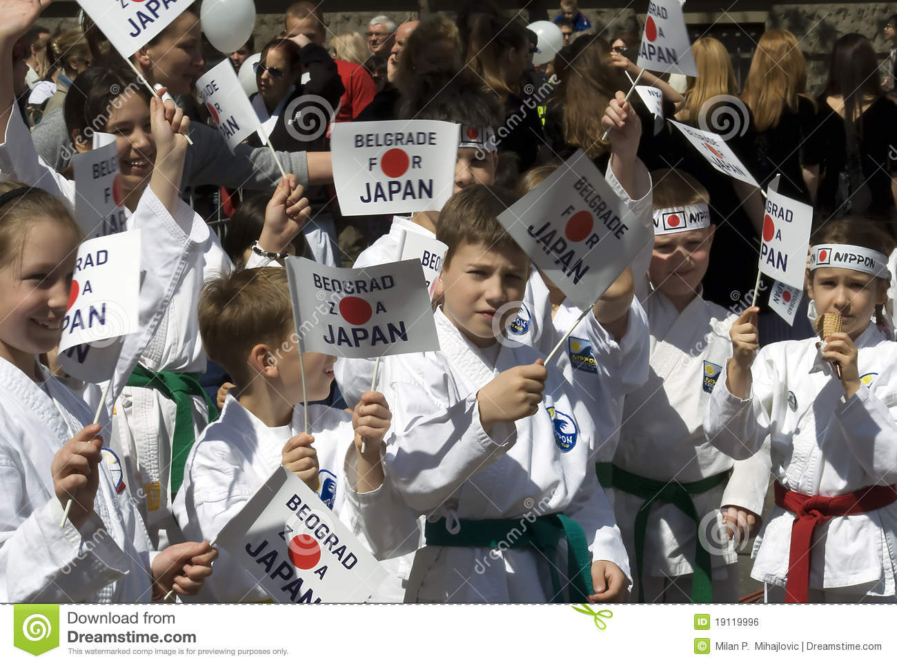 Children with banners supporting Japan
