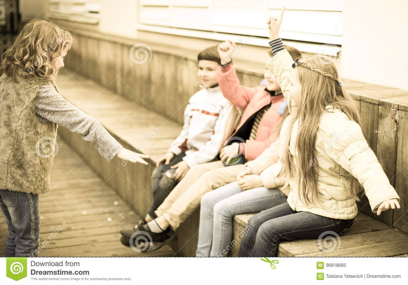 Download Children On Bench Playing Children`s Games Stock Image - Image of group, game: 96818685