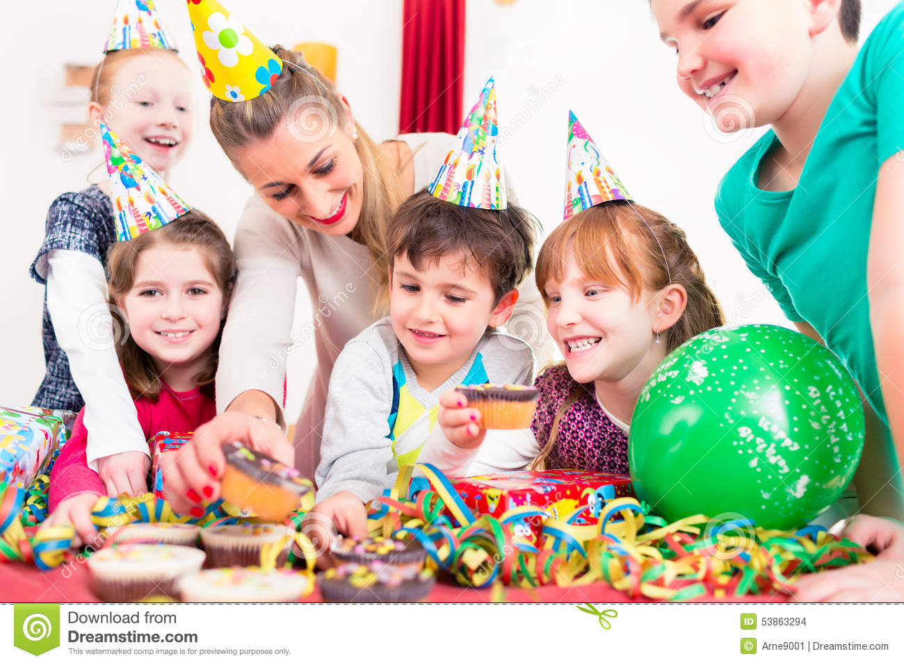 Children At Birthday Party With Muffins And Cake Stock