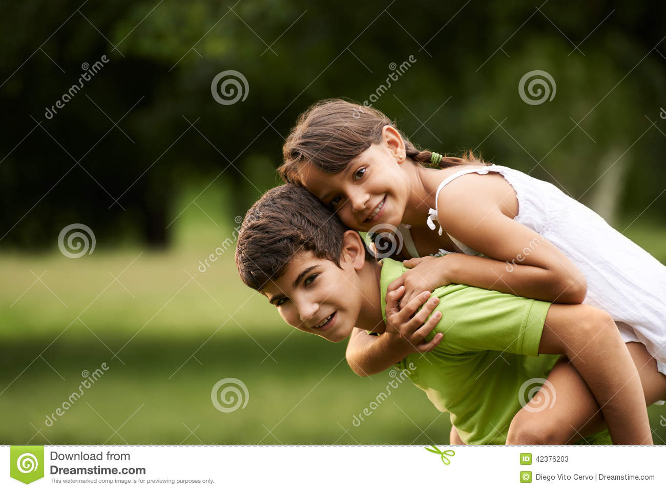 Children Boy And Girl In Love Running Piggyback Park Stock ...