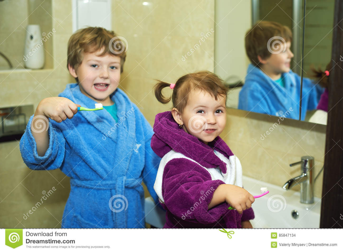 97d67c60b6 Brother and sister brushing my teeth in the bathroom
