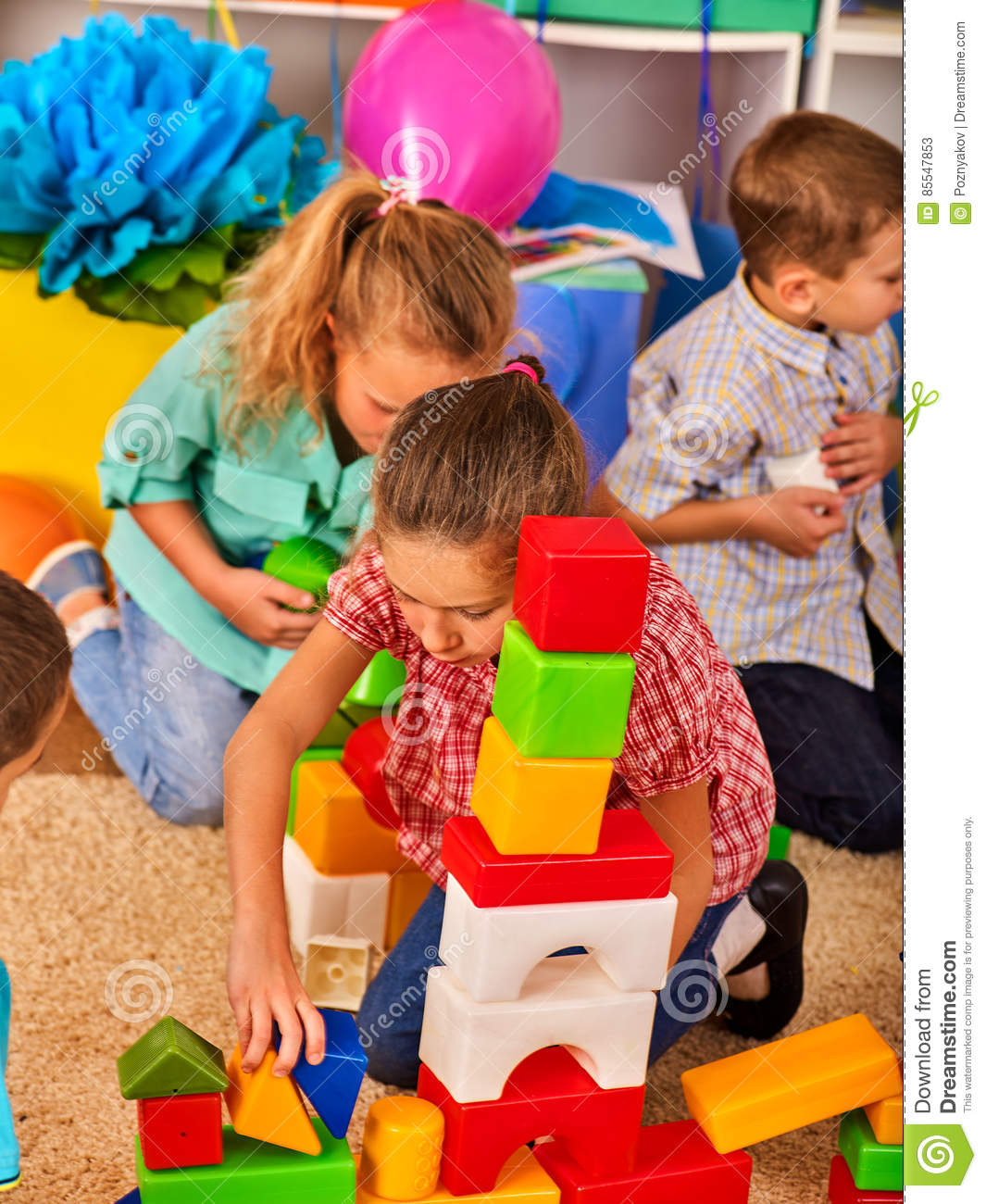 Toys For Kindergarten : Children building blocks in kindergarten group kids