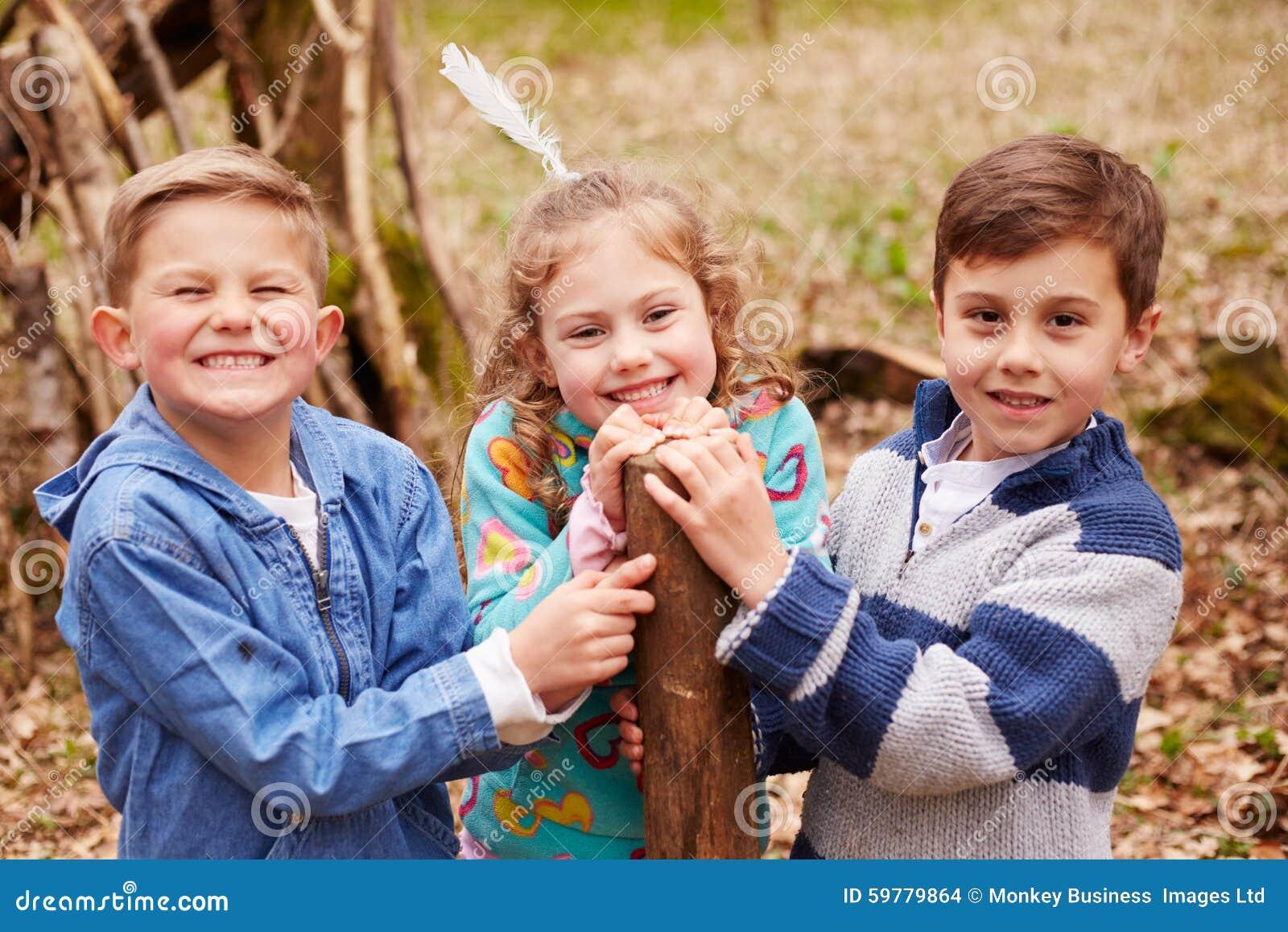 Children Building Camp In Forest Together