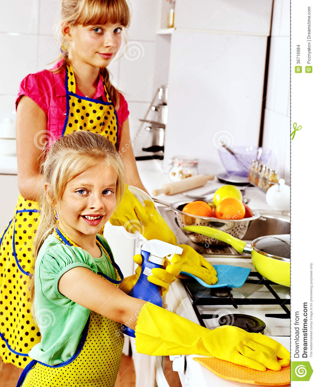 Children cleaning kitchen. stock photo. Image of home ...