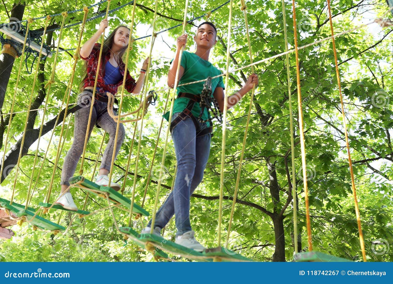 Children climbing in adventure park. Summer camp