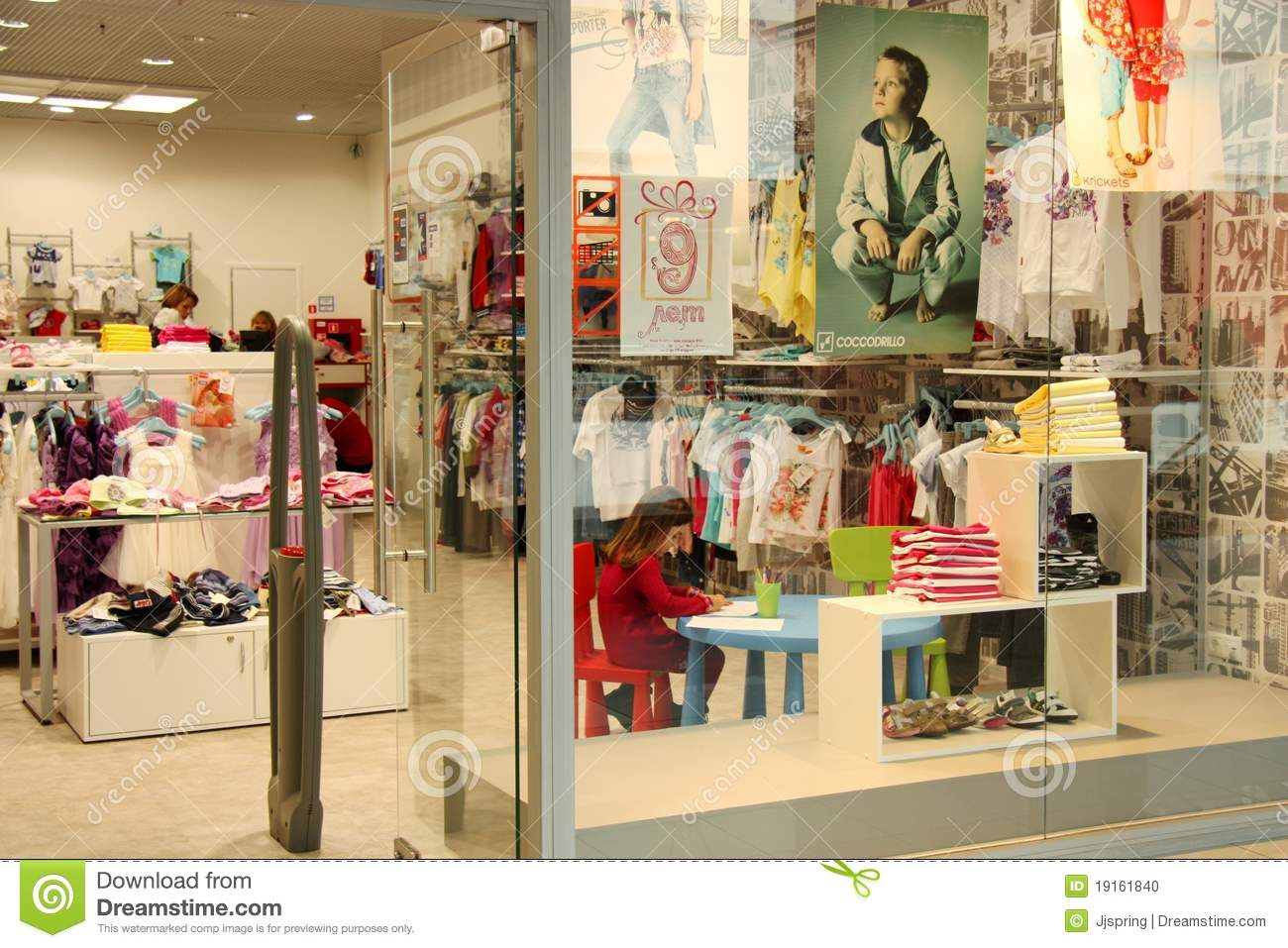 24b5a4b1f3b Children clothes shop window and a small customer in it. Designers ...