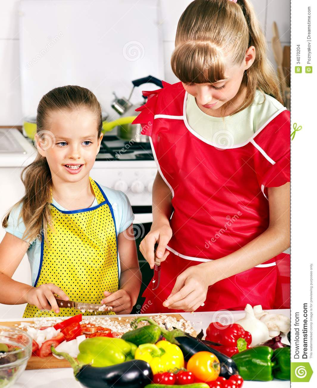 Children cooking at kitchen stock images image 34070204 for Girls kids kitchen