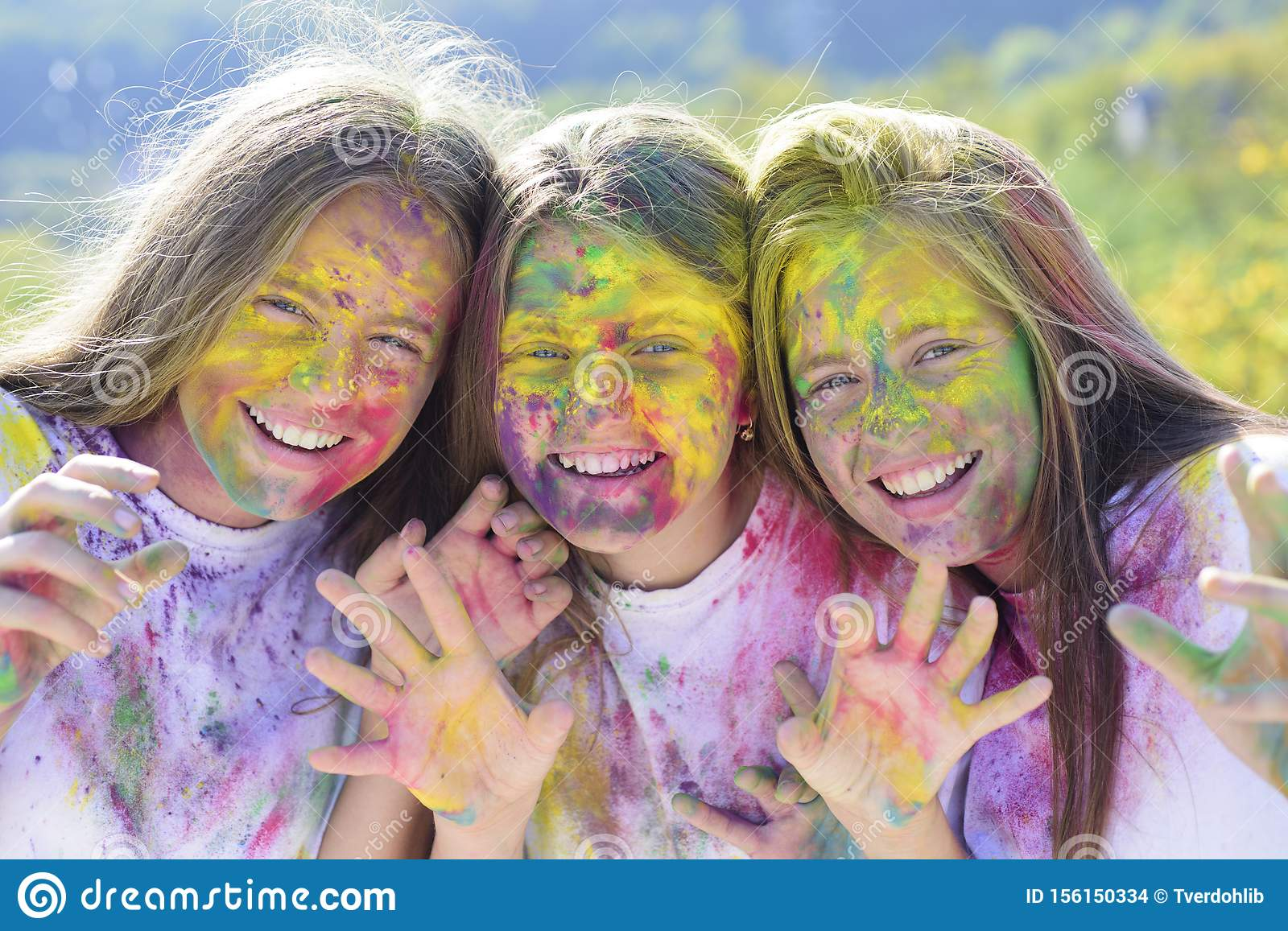Children with creative body art. Crazy hipster girls. Summer weather. positive and cheerful. colorful neon paint makeup