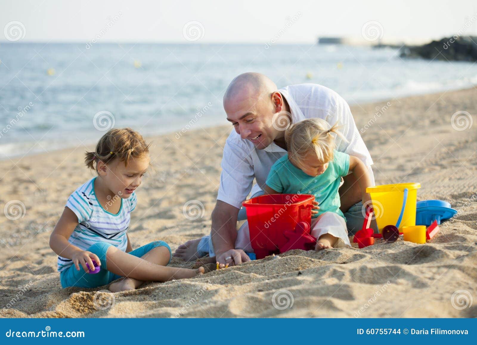 Children with Dad on beach