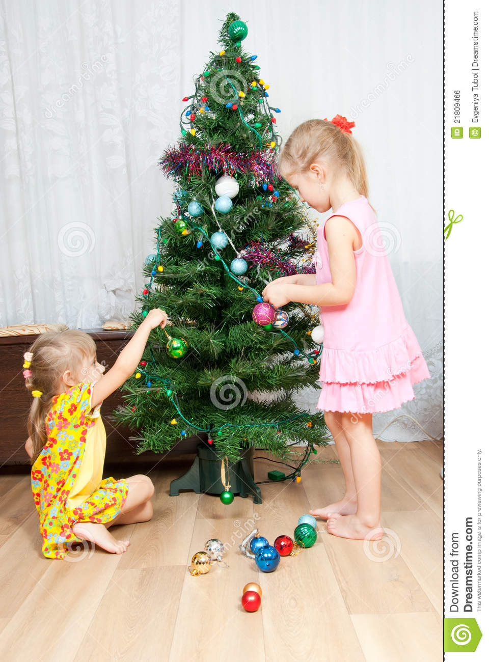 Children Decorate The Christmas Tree Royalty Free