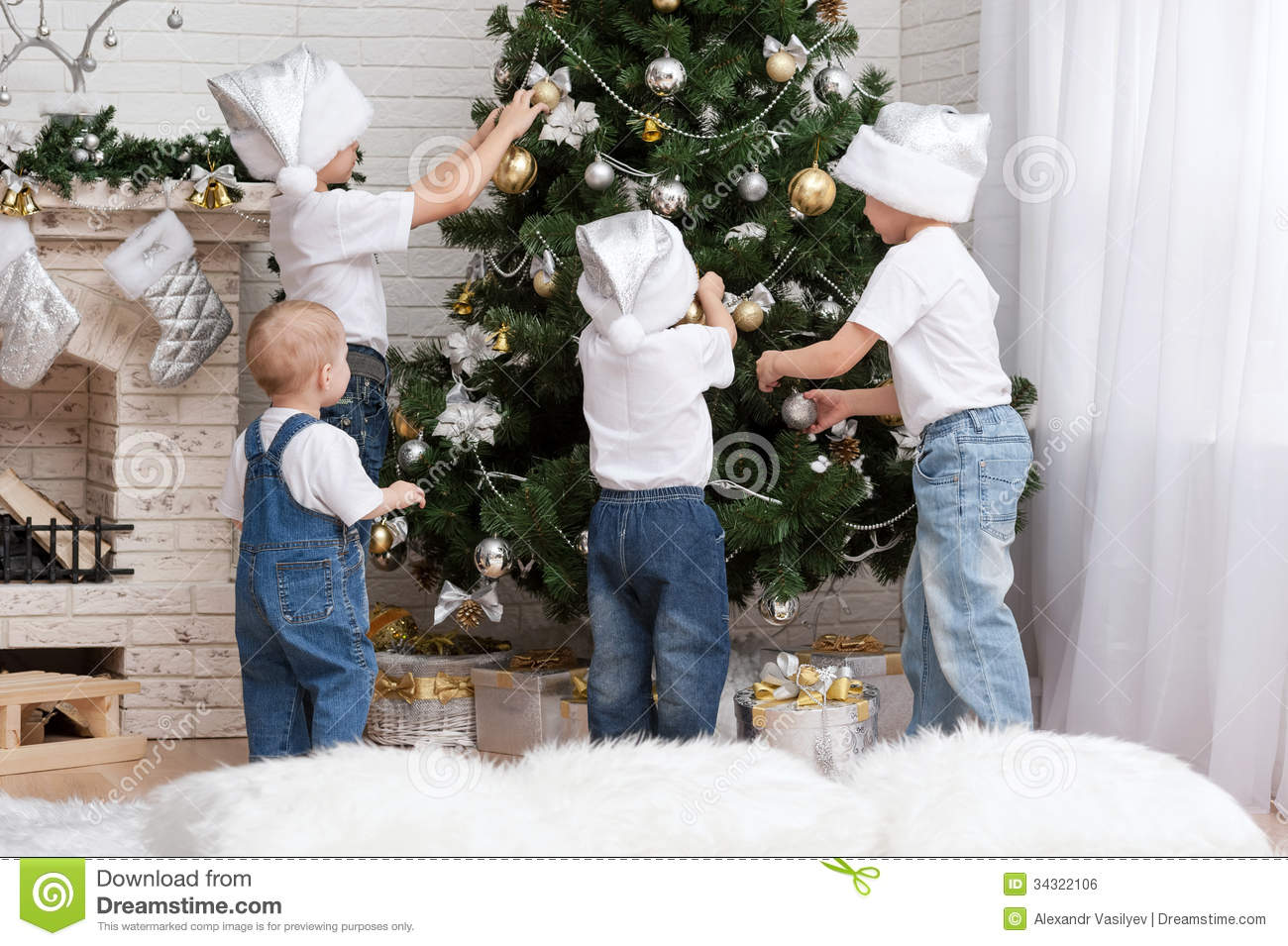 Children decorate a christmas tree toys stock photo for How to decorate