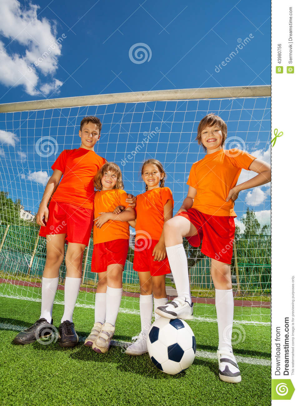 Children of different height with football