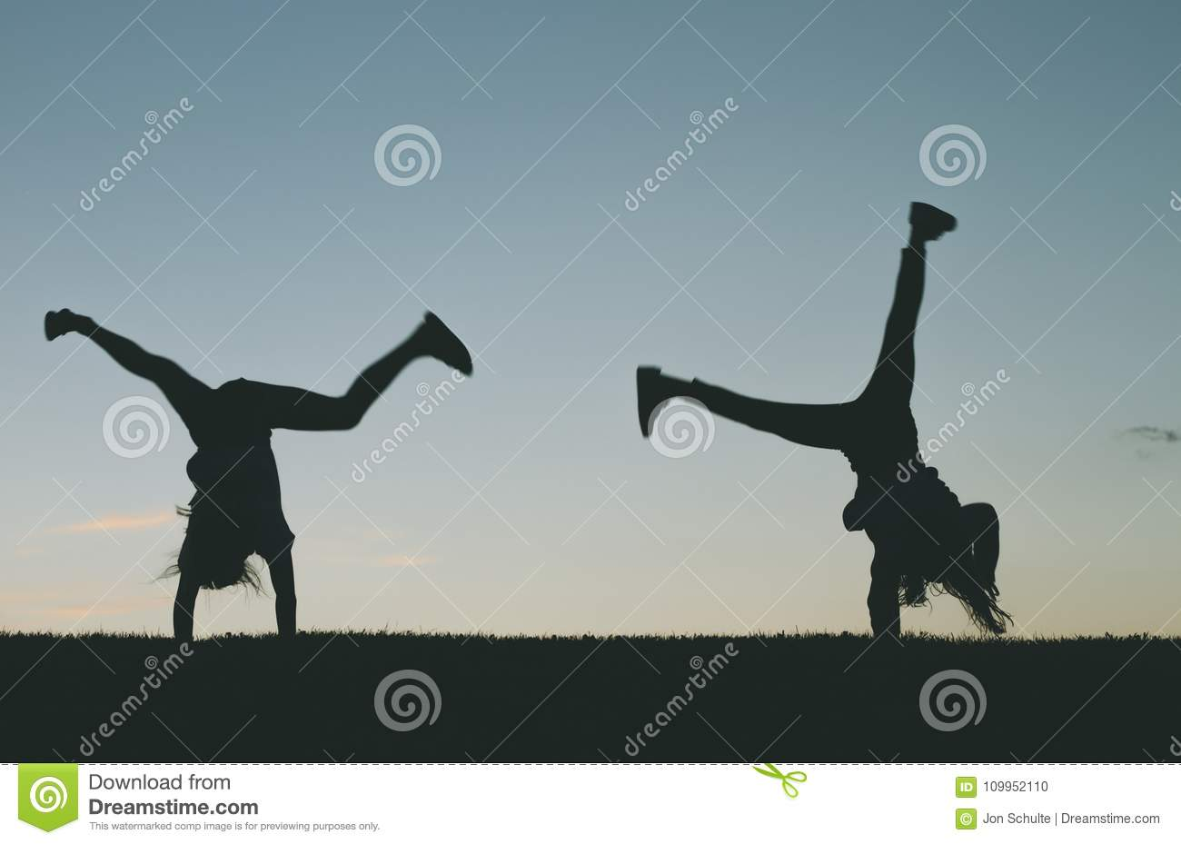 Children doing cartwheels silhouette