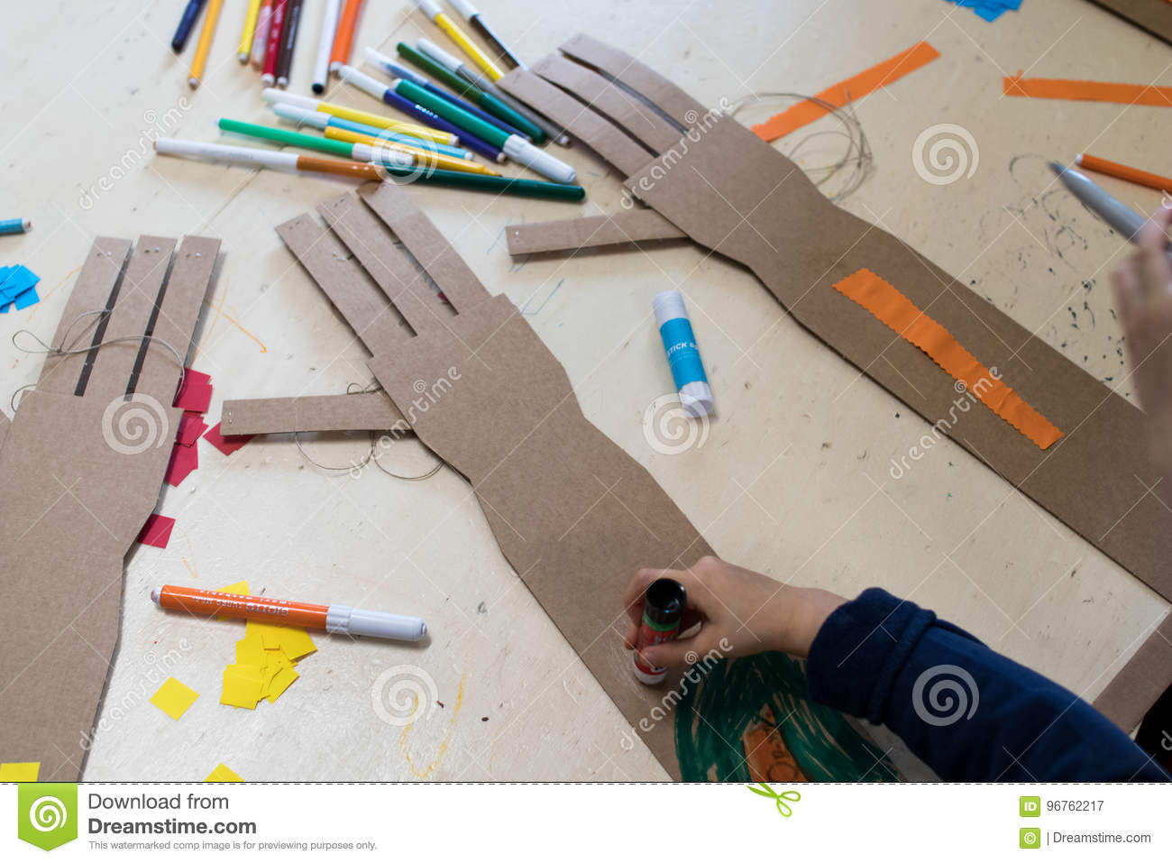 Children Is Drawing A Robotic Arm Made With Cardboard