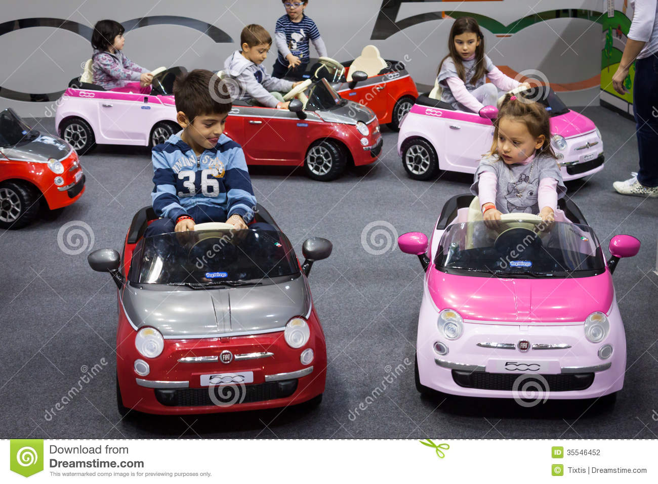 children driving electric cars at g come giocare in milan italy editorial photography image. Black Bedroom Furniture Sets. Home Design Ideas