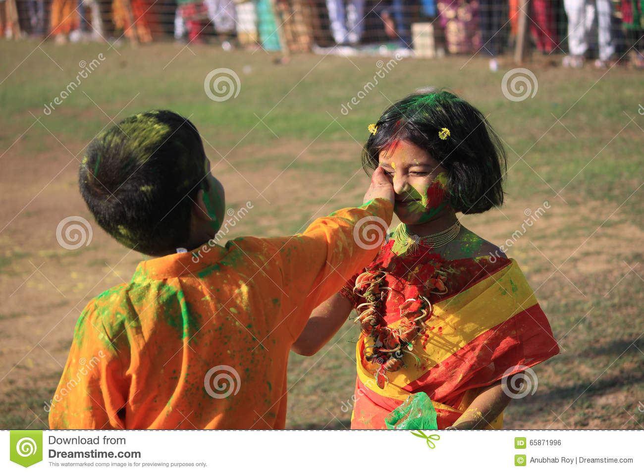 Children are enjoying Holi, the color festival of India.
