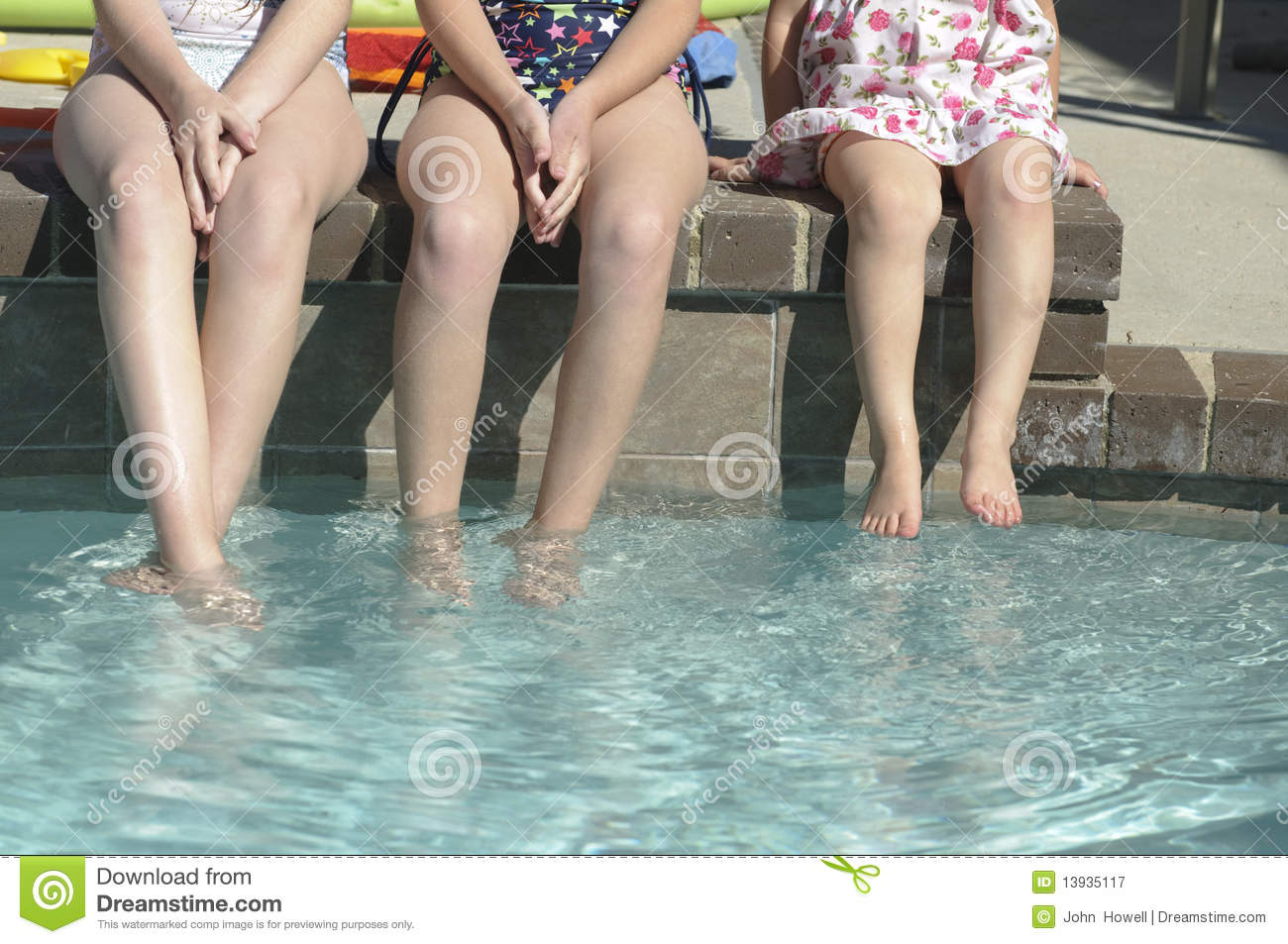 Children with feet in pool