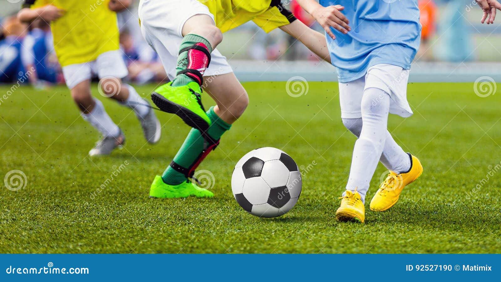Children Football Players Running After the Ball. Kids Sport Duel