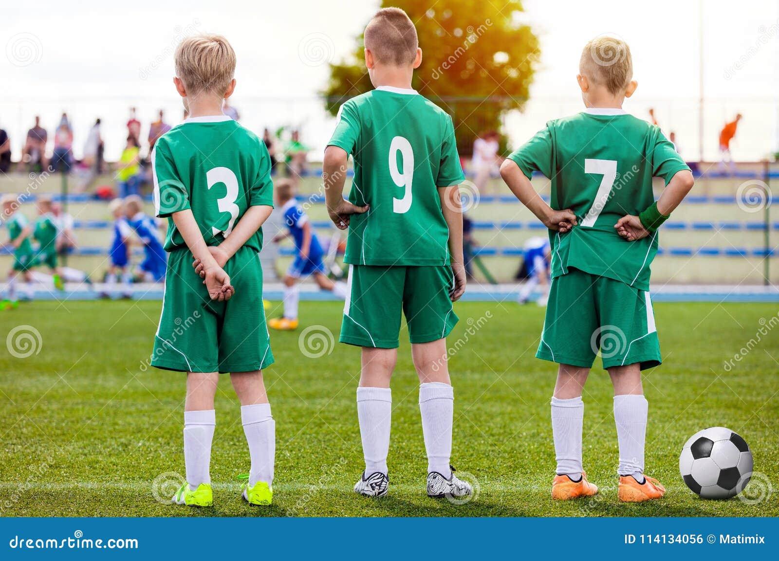 Children Football Team. Young Boys Watching Soccer Match