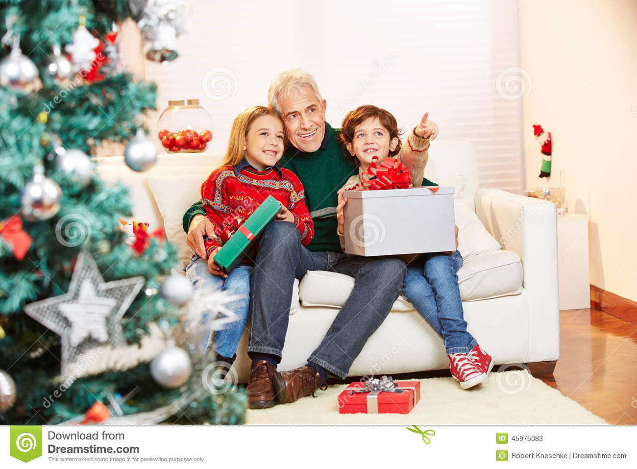Children With Gifts And Grandfather At Christmas Stock Image - Image ...