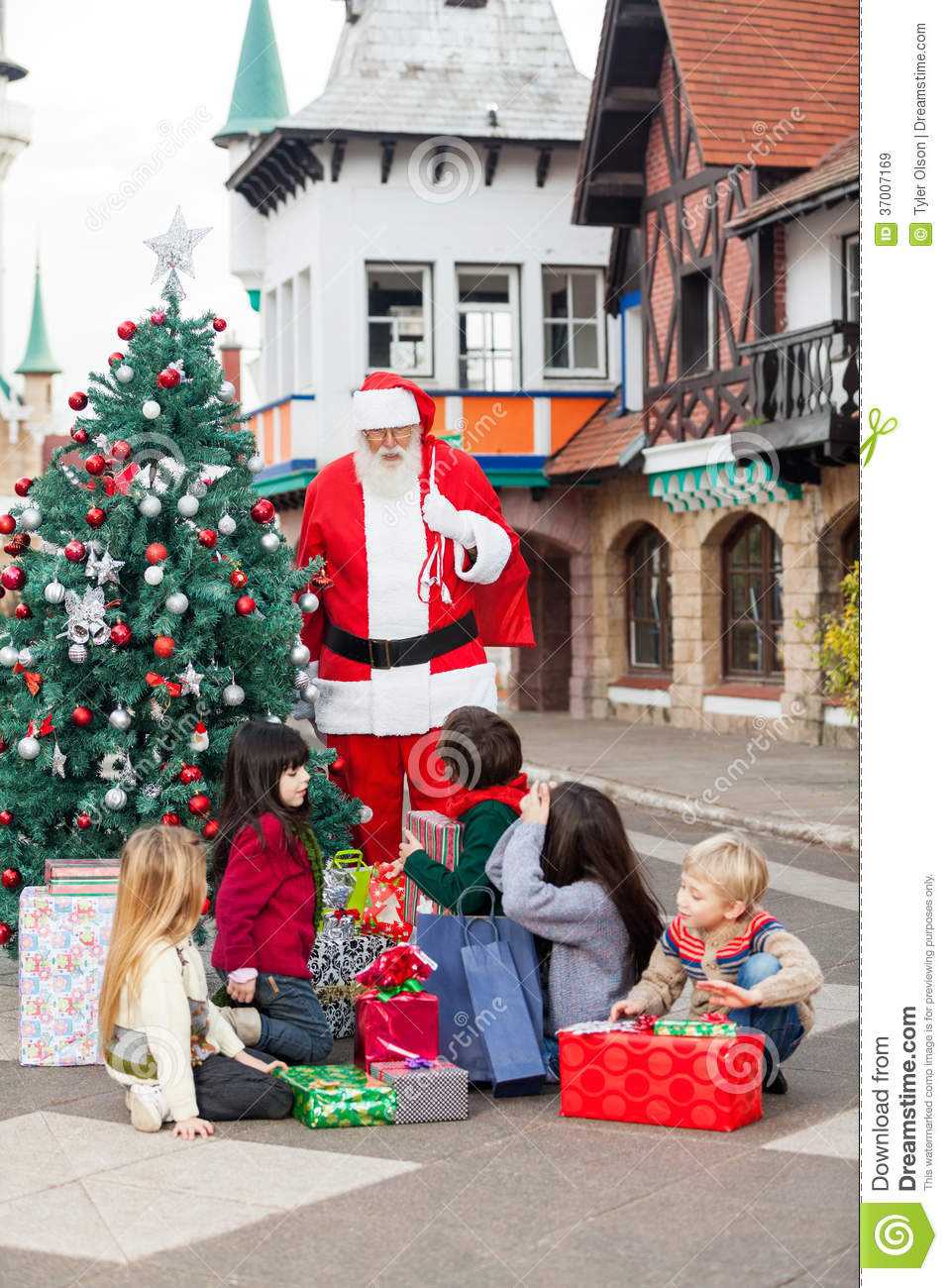 Children With Gifts Looking At Santa Claus Royalty Free ...