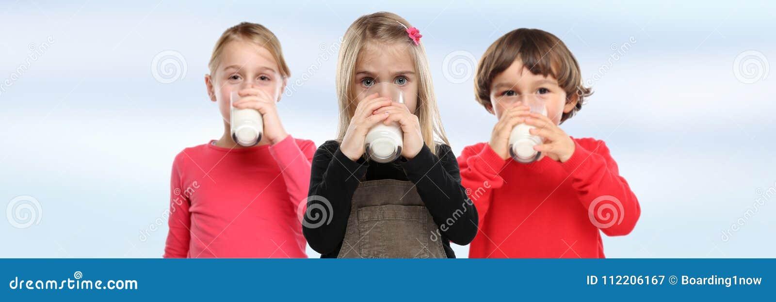 Children girl boy drinking milk kids glass banner copyspace heal