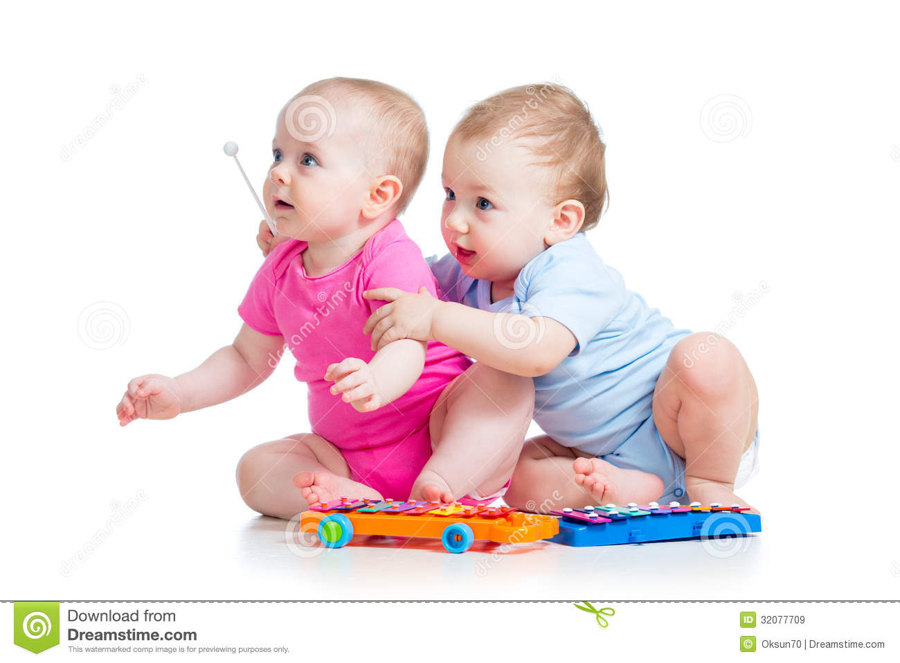Girls From Boy Toys : Children girl and boy play musical toys stock image