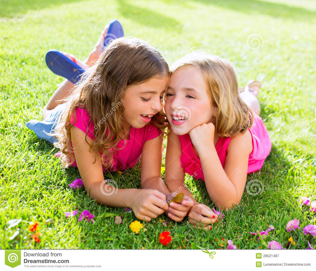 Young Happy Beautiful Family Playing Together On The Beach: Children Girls Playing Whispering On Flowers Grass Royalty
