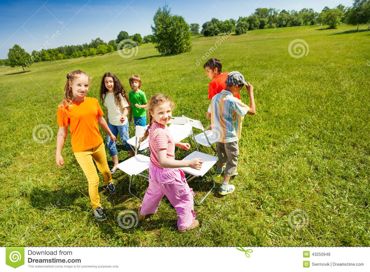 Musical chair game for kids - Royalty Free Stock Photo Download Children Go Around Playing Musical Chairs