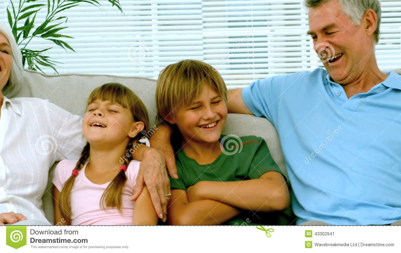 Children With Grandparents On The Couch Stock Video - Video of male ...