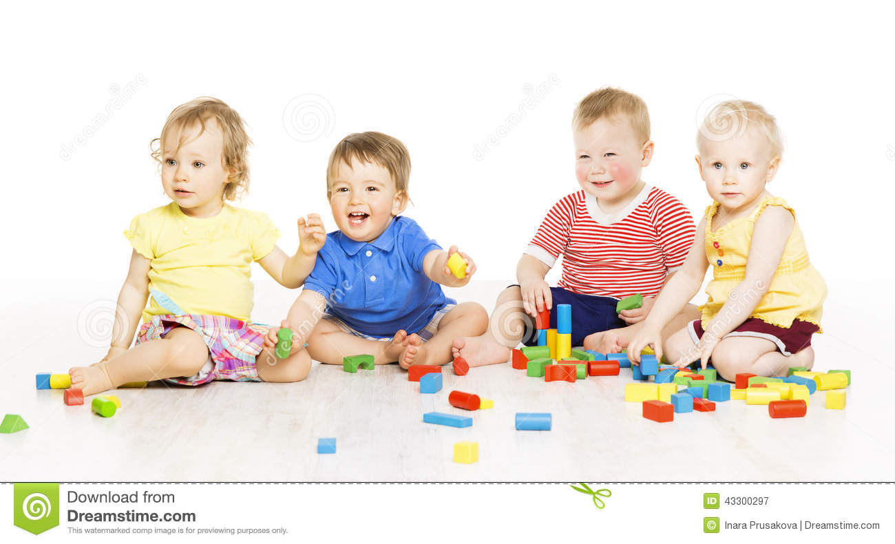 children group playing toy blocks small kids on w - Small Children Images
